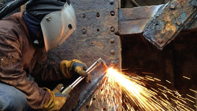 Welder Justin Steele works on the gate of Lock 27 in Lyons, Wayne County, in March. A new audit is highly critical of the Canal Corp.'s safety inspection record.