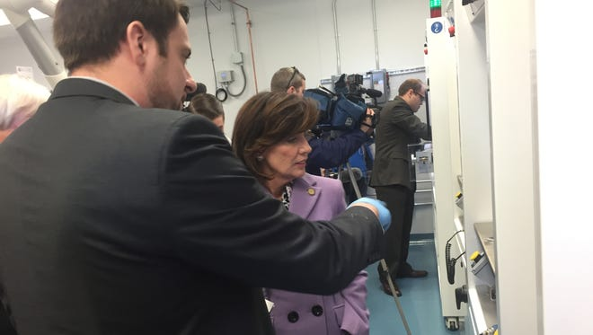 Matthew Ganter, co-director of RIT's Battery Prototyping Center, explains some of the equipment to Lt. Gov. Kathy Hochul following a ribbon cutting on the center Friday.