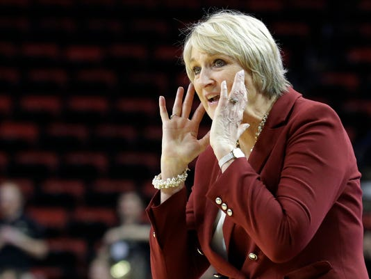 Washington State coach June Daugherty calls to her team during the second half of an NCAA college basketball game against Colorado in the Pac-12 tournament, Thursday, March 2, 2017, in Seattle. Washington State won 79-78. (AP Photo/Ted S. Warren)