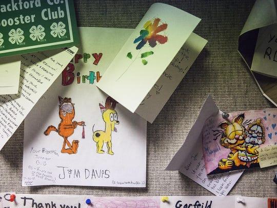 Fan art hangs in a hallway at Paws, Inc.