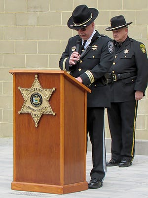 Allegany County Sheriff Rick Whitney reads the names of the fallen as Steuben County Sheriff Jim Allard looks on at the third annual Law Enforcement Memorial Service was Saturday at the Steuben County Public Safety Building.