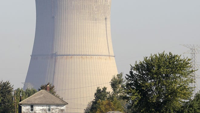 FILE - This Oct. 5, 2011 file photo shows the cooling tower of the Davis-Besse Nuclear Power Station in Oak Harbor, Ohio. A financial rescue for Ohio's nuclear plants and two coal-fired plants has infuriated environmentalists and conservatives. The plan signed into law it July 23, 2019 by Republican Gov. Mike DeWine calls for giving the state's two nuclear plants $150 million a year through 2026. (AP Photo/Amy Sancetta, File)