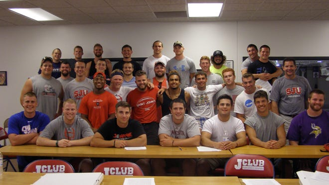 The group of players who form the newly-created leadership group on the St. John's football team pose at the group's first meeting on Aug. 14.
