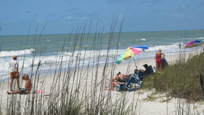 Delnor-Wiggins Pass State Park attracts beachgoers for its unspoiled beauty.