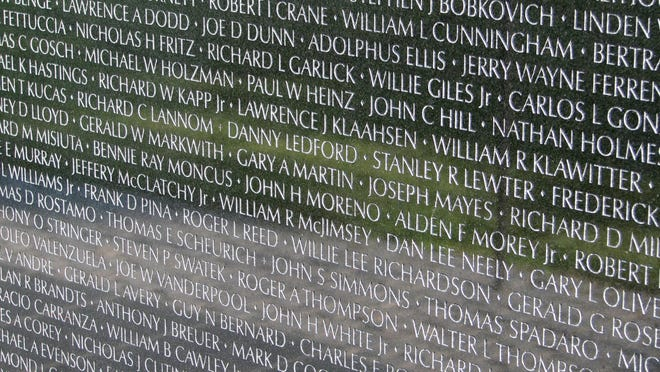 Names of American servicemen and women who died in Vietnam carved on the Vietnam Veterans Memorial in Washington, D.C.