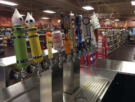 Craft beers on tap at a Columbus Kroger beer station.