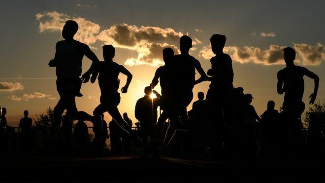 Runners start the 1600 during a 2017 track & field meet
