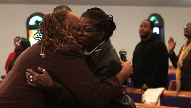 Valerie Lawrence, left, hugs Gail McRae at announcement ceremony for a new recovery program at Greater Adams Street Church of God by Faith.