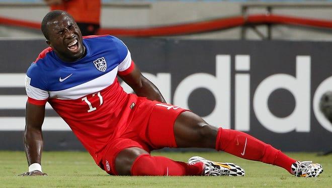 U.S. forward Jozy Altidore grabs his leg in pain Monday.