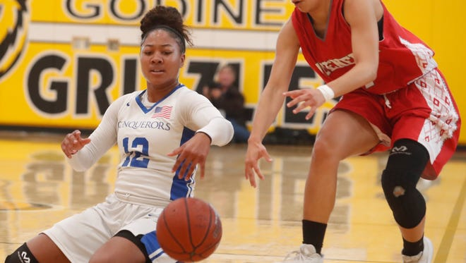 At left, Desert Christian Academy's Aysia Johnson battles for control of the ball against Hueneme's player during their CIF Championship game at Godinez High School in Santa Ana, California on March 3, 2018.