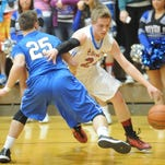 Union County's Bryce Fields drives around Eastern Hancock's Cooper Henderson during Tuesday's Class 2A Sectional 41 game at Hagerstown.
