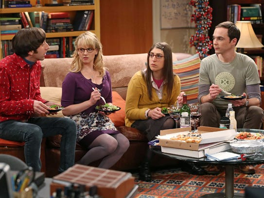 "This image released by CBS shows, from left, Simon Helberg, Melissa Rauch, Mayim Bialik and Jim Parsons in a scene from ""The Big Bang Theory."" CBS says it's renewing its hit comedy ""The Big Bang Theory"" for three more years. This extraordinary deal would carry TV's most-watched sitcom through the 2016-2017 season, the series? tenth on the air. ""The Big Bang Theory"" premiered in September 2007, and has been a ratings smash for virtually its entire run. This season it has averaged nearly 20 million viewers each week. (AP Photo/CBS, Michael Yarish)"