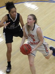 Dickson County's Ryann Roberts drives past Antioch's