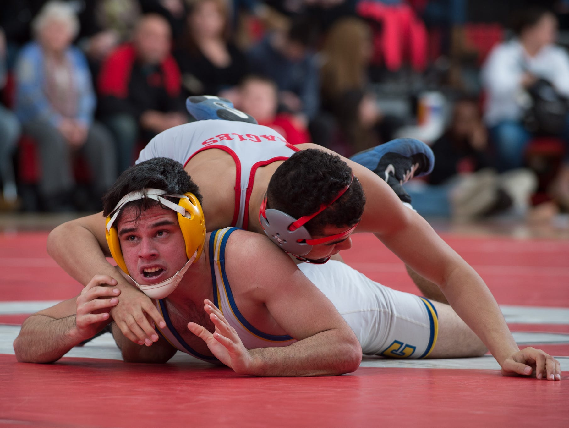 Sussex Central's Tyler Bunting, left, checks the clock in his match against Smyrna's Nate Bryant at 152 pounds last Friday. Smyrna won 39-27 to clinch the Division I top seed in the DIAA Dual Meet Wrestling Championships.