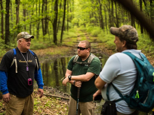 Don Short, Brad and Dave Levack chat as they search for a Sasquatch a forest located in Schyulkill County on Saturday, May 27, 2017
