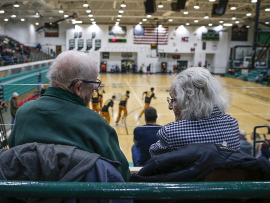 Ken and Joan Kenipe, who were both freshman at Arsenal Technical High School in 1946, watch as Tech faces off against McCutcheon on Thursday, Dec. 28, 2017. The Kenipe's have only missed a handful of games since 1946.