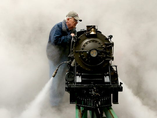 Don Deffley is enveloped in steam as he performs a