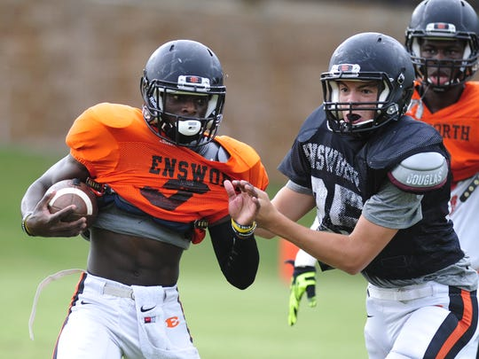Ensworth running back Darius Morehead (left).