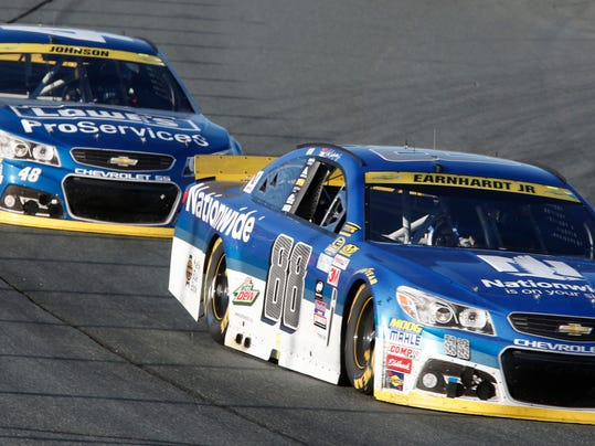 Dale Earnhardt Jr. (88) races with Jimmie Johnson (48) during the NASCAR Sprint Cup series auto race at New Hampshire Motor Speedway on Sunday, Sept. 27, 2015, in Loudon, N.H.  (AP Photo/Jim Cole)