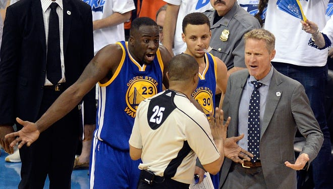 Golden State Warriors forward Draymond Green, guard Stephen Curry and head coach Steve Kerr argue with official Tony Brothers after Green was called for a Flagrant 1 in Game 3 on Sunday.