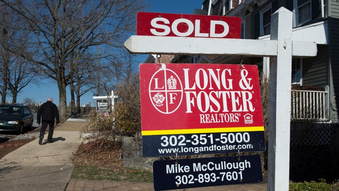 """A """"sold"""" sign in a neighborhood in Wilmington, Del."""