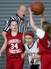 Harry Coenen was not only a barber but also a referee for student sports. Here, in a 2010 file photo, he referees a youth basketball tournament.