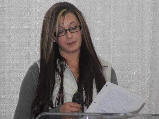 Christin Pennington speaks to the audience that gathered for the Marion County F.I.R.S.T. Drug Court graduation.