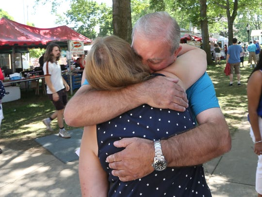 Graham Hipworth, Irondequoit, a native of Great Britain, hugs wife Karem Hipworth, following his oath of citizenship during the Naturalization Ceremony for new citizens of the United States held Tuesday, July 4, on the front steps of Irondequoit Town Hall.