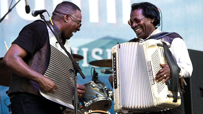 Sir Reginal Dural, left, and his father, Stanley Dural Jr., lead Buckwheat Zydeco at the 2015 Festival International de Louisiane.