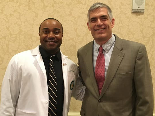Medical student Justin Lewis, left, was honored by