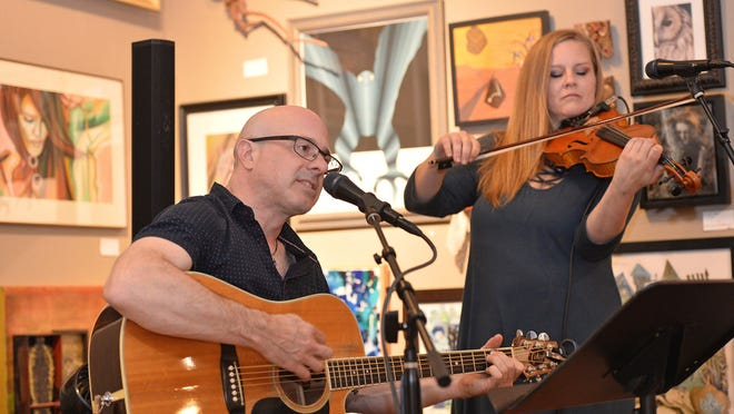 Doug Phillips, left, and Amanda Barton, are shown during a 2019 Gallery Night. They're scheduled to perform this weekend at Five & 20 Spirits & Brewing in Westfield, N.Y.