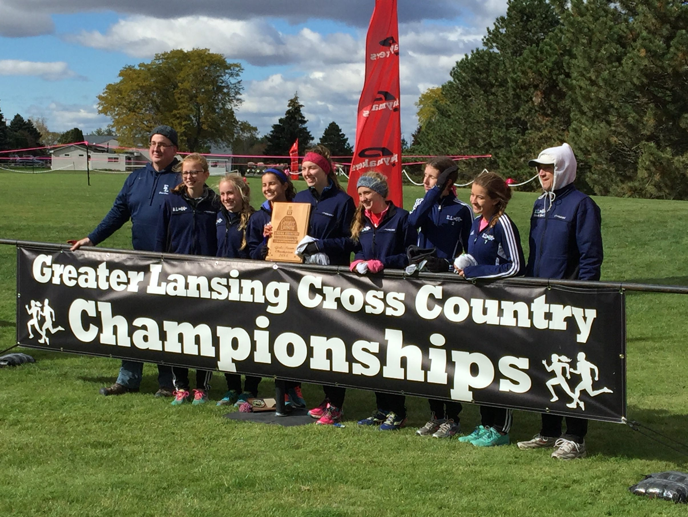 The East Lansing girls cross country team edged DeWitt for the team title at the Greater Lansing Cross Country Championships.
