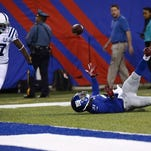 FILE - Colts wide receiver Reggie Wayne hauls in a pass that was called a touchdown then nullified in the first half December 16, 2012. Regardless of the outcome, Wayne has made a habit out of making acrobatic grabs during his career.