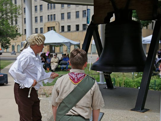 Citizens lined up to ring the Liberty Bell on the Brown