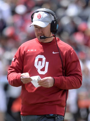 Oklahoma Sooners head coach Lincoln Riley looks at his playlist during the spring game at Gaylord Family Memorial Stadium.