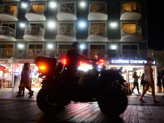 A police officer on a 4-Wheeler patrols the boardwalk