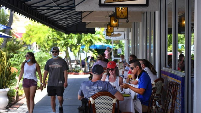 Diners enjoy lunch outdoors at the iconic Columbia Restaurant, which has been welcoming guests to its St. Armands Circle location in Sarasota since 1959.