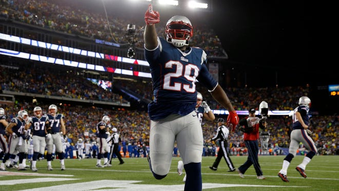 New England Patriots running back LeGarrette Blount (29) celebrates after scoring a touchdown during the first quarter against the Indianapolis Colts in the AFC Championship Game at Gillette Stadium.