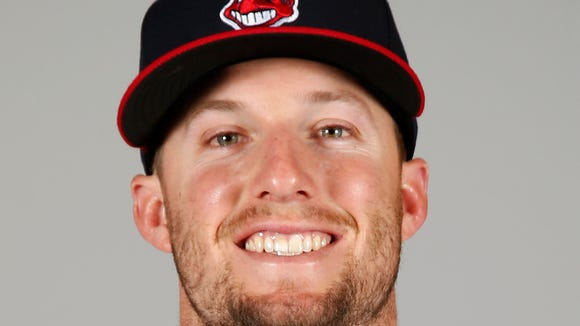 Cleveland Indians right fielder Tyler Holt (62) poses