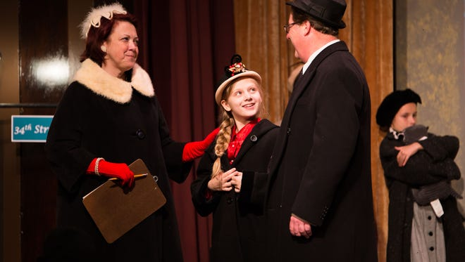Fred played by Greg Reitsma, Doris by Kim Forde, left, and Susan by Ella Smith practices in their recital during the upcoming production of Miracle on 34th Street at the Franke Center for the Arts in Marshall.