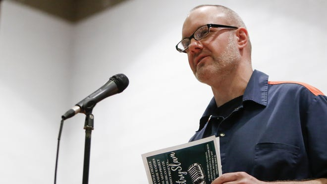 Prison inmate Michael Duthler reads a poem Tuesday, Dec.. 5, 2017, at the Richard A. Handlon Correctional Facility in Ionia as part of the Free Verse Arts Project Poetry Slam.   Inmates and students from MSU's The Residential College in the Arts and Humanities met weekly for a semester to learn about and write poetry.  Duthler is serving a life sentence for second-degree murder.