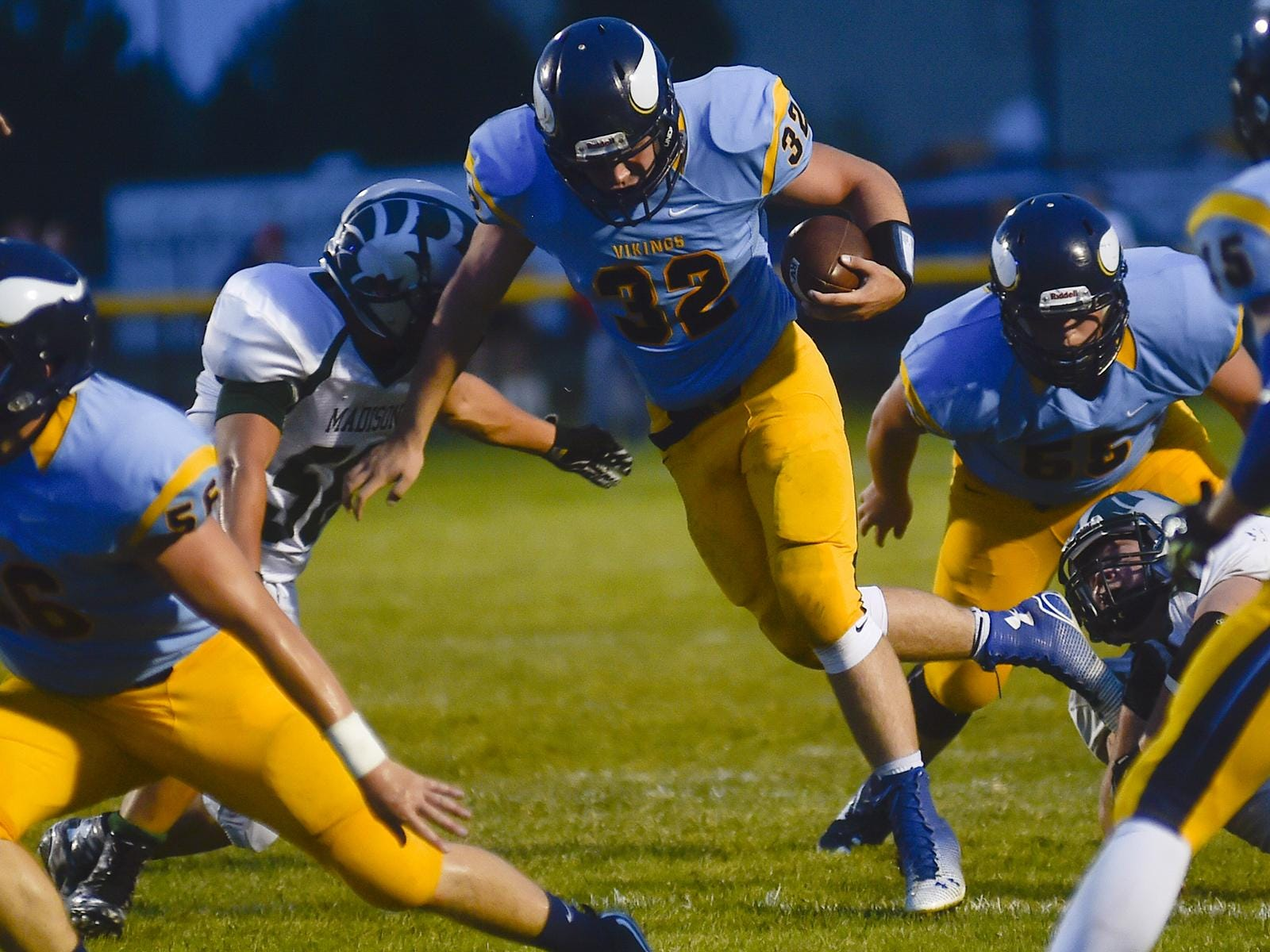 River Valley's Zack Warwick makes breaks for a hole in the Ram's defense during the Madison vs River Valley football game on Friday.