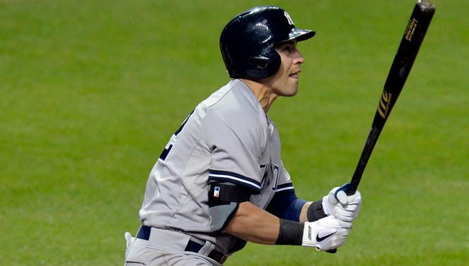Yankees center fielder Jacoby Ellsbury hits a solo home run in the 14th inning against the Cleveland Indians at Progressive Field.