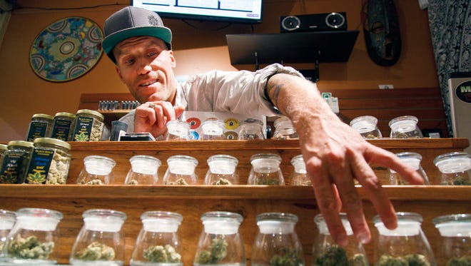 Shane Cavanaugh in his cannabis store in Eugene, Ore., in 2016.