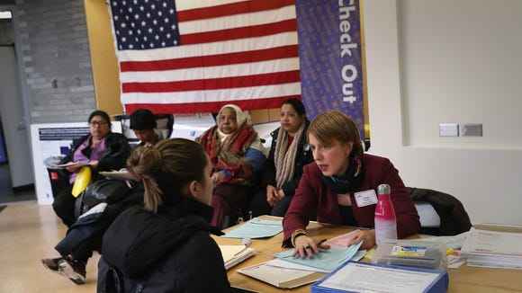 Immigrants receive assistance with their U.S. citizenship applications at a Citizenship Now! event in New York City