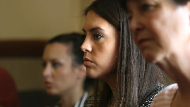 Noura Jackson listens to District Attorney Amy Weirich's hearing before a professional panel on a misconduct charge.