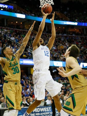 Mar 28, 2015; Cleveland, OH, USA; Kentucky Wildcats forward Karl-Anthony Towns (12) goes up for a shot while guarded by Notre Dame Fighting Irish guard/forward Pat Connaughton (24) and  forward Zach Auguste (30) during the first half in the finals of the midwest regional of the 2015 NCAA Tournament at Quicken Loans Arena. Mandatory Credit: Rick Osentoski-USA TODAY Sports