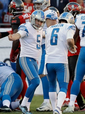 Detroit Lions kicker Matt Prater (5) celebrates with holder Sam Martin (6) after Prater kicked the winning field goal against the Tampa Bay Buccaneers Sunday, Dec. 10, 2017 in Tampa, Fla.