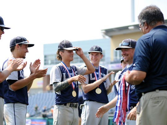 Members of the Lancaster County Christian baseball team receive their PIAA Championship medals following an 8-0 victory over Eisenhower at Medlar Field.