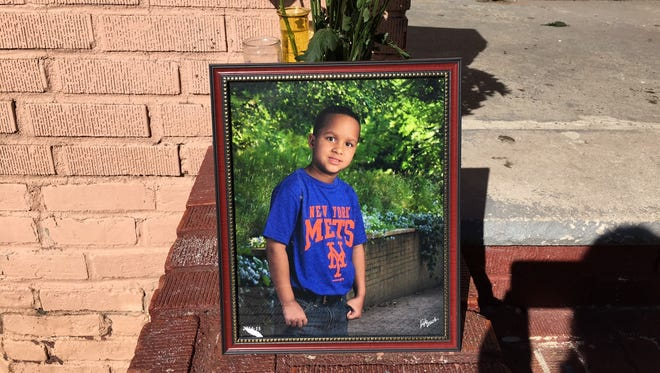 A memorial for Dariel Sosa, 9, who died after falling from a second-story deck, is outside the boy's Brighton Avenue home in Perth Amboy.